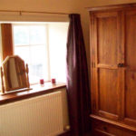 Photograph of the master bedroom in Clougha View Cottage